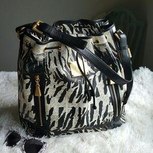 LAMB Zebra Newsprint shoulder bag